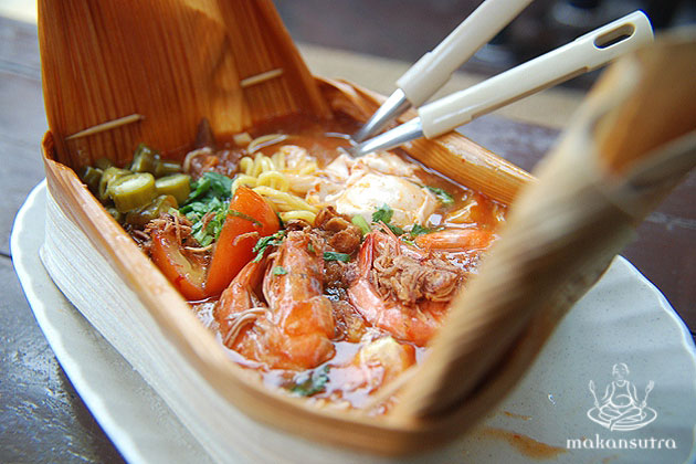 Mamu mee kuah opeh at bedok hawker centre intriqued them with the way he packed it.