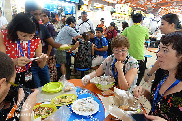 Media curiously hungry at tian tian chicken rice.